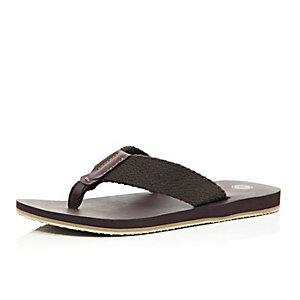 Brown woven flip flops