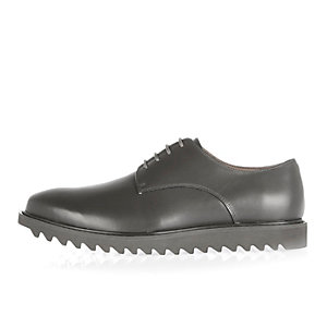 Grey leather cleated sole shoes
