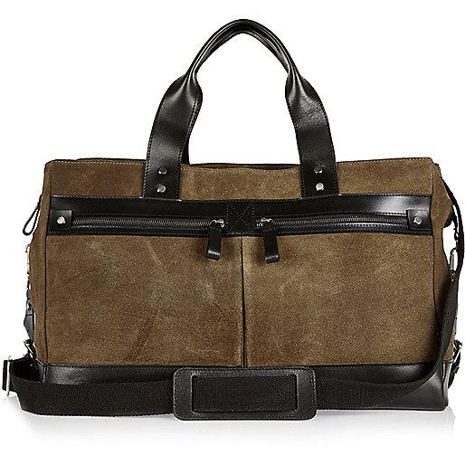 Dark green leather holdall bag