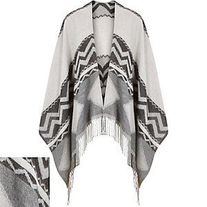 Black geometric tasselled cape