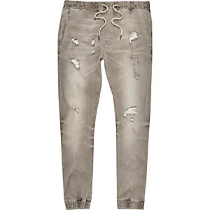 Grey grungy ripped denim joggers