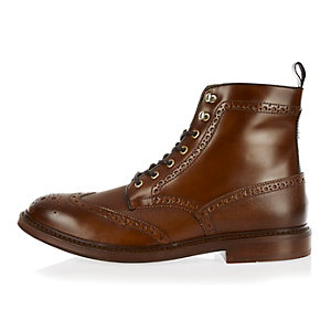 Tan leather lace-up wingtip boots