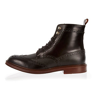 Black leather lace-up wingtip boots