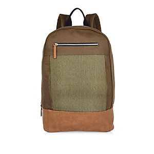 Light brown canvas backpack