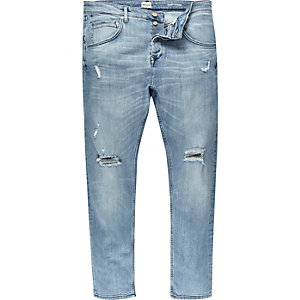 Light wash distressed Chester tapered jeans