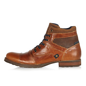 Brown leather perforated boots