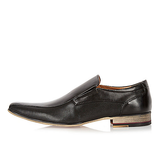 Black perforated slip on shoes
