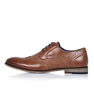 Brown embossed brogues