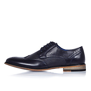 Navy blue embossed brogues