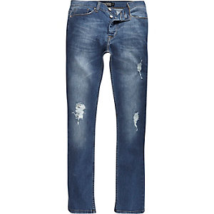 Mid blue wash ripped Antioch skinny jeans