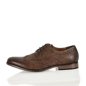 Dark brown wingtip formal shoes