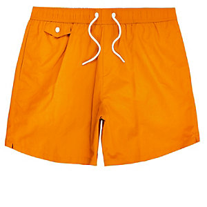 Bright orange pocket swim trunks