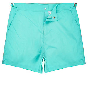 Bright green swim trunks