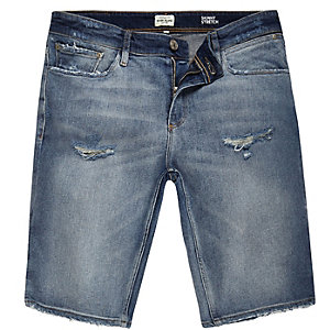 Blue denim distressed skinny stretch shorts