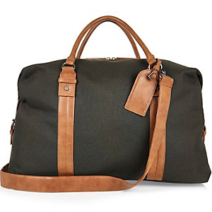 Dark green canvas holdall bag