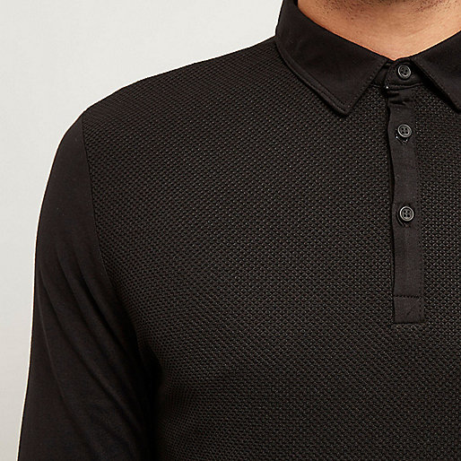 Polo noir texturé à manches longues