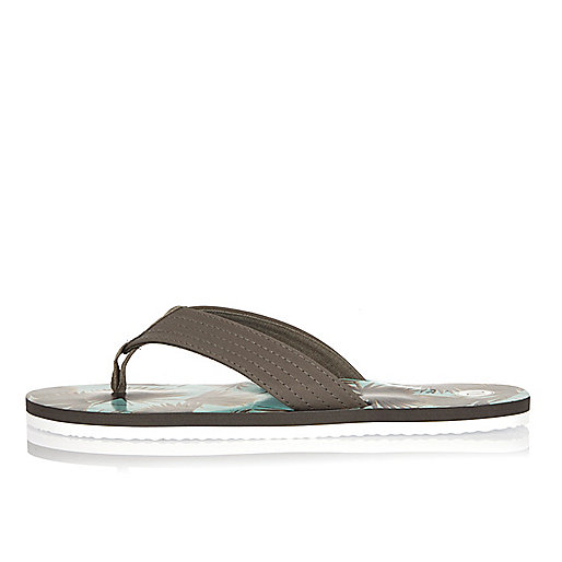 Grey tropical print flip flops