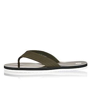 Khaki tropical print flip flops