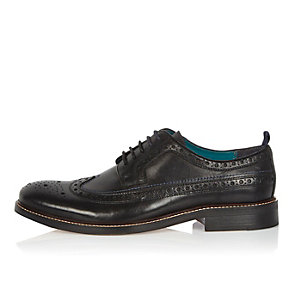 Black leather wingtip brogues