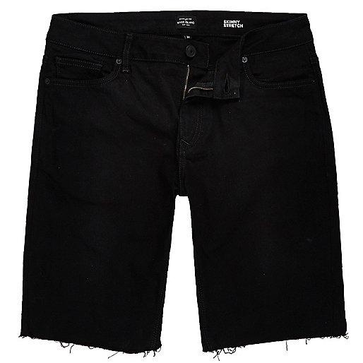 Schwarze Skinny Jeansshorts mit Fransen