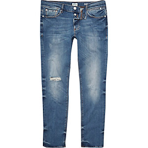 Mid blue wash distressed Eddy skinny jeans