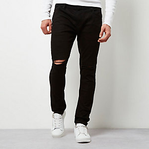 Black ripped Sid skinny jeans