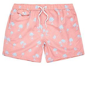 Pink palm tree print swim shorts