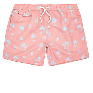 Pink palm tree print swim trunks