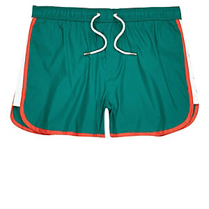 Turquoise color block runner swim trunks