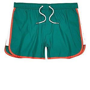 Turquoise color block runner swim trunks