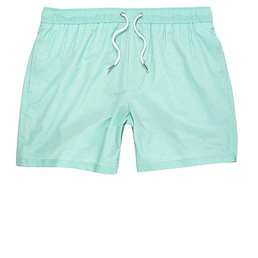 Mint green swim trunks