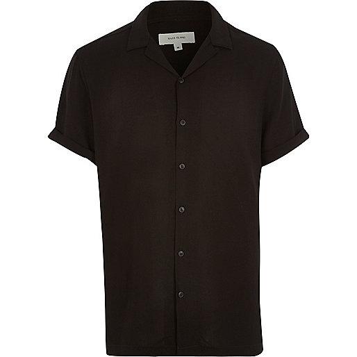 Schwarzes, ärmelloses Hemd
