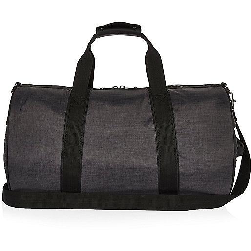 Graue, gesteppte Reisetasche