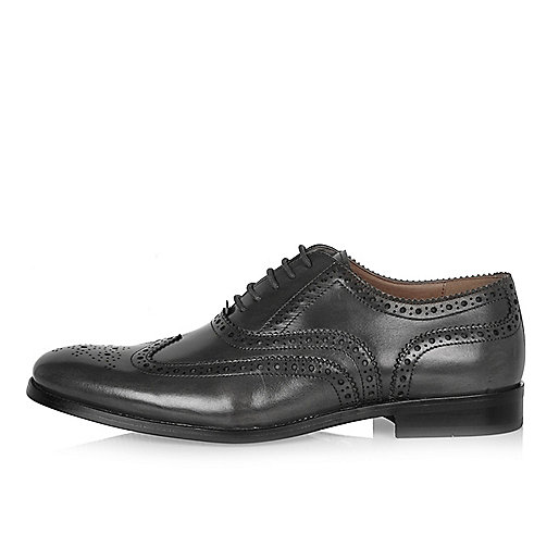 Grey leather brogues