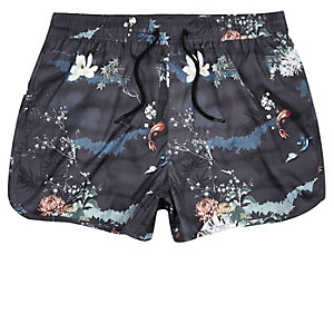 Black oriental print runner swim trunks