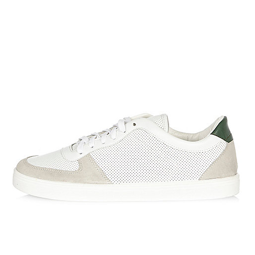 White and green perforated trainers