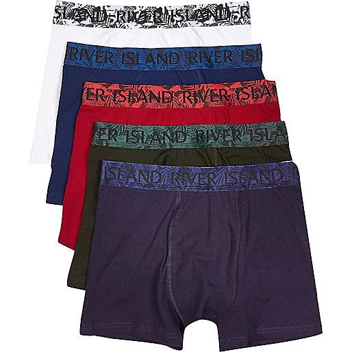 Lot de boxers dont un imprimé végétal rouges