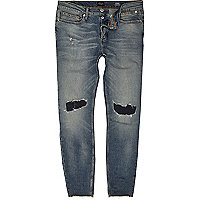 Faded blue wash ripped Sid skinny jeans