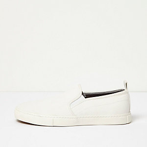 White textured plimsolls