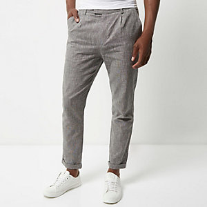 Grey pleated tapered trousers