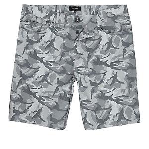 Grey camouflage print frayed shorts