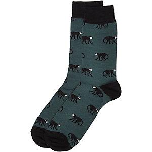 Dunkelgrüne Socken mit Affenmuster