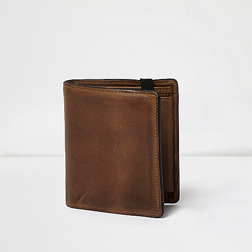 Tan leather foldout wallet