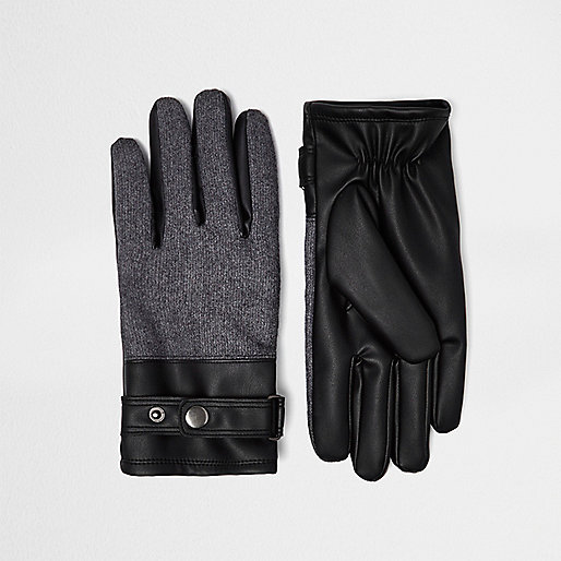 Schwarze Handschuhe mit Bahn in Lederoptik