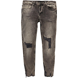 Black paint splattered Sid skinny jeans