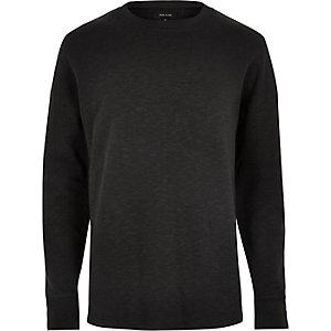 Schwarzes Sweatshirt mit fallenden Schultern