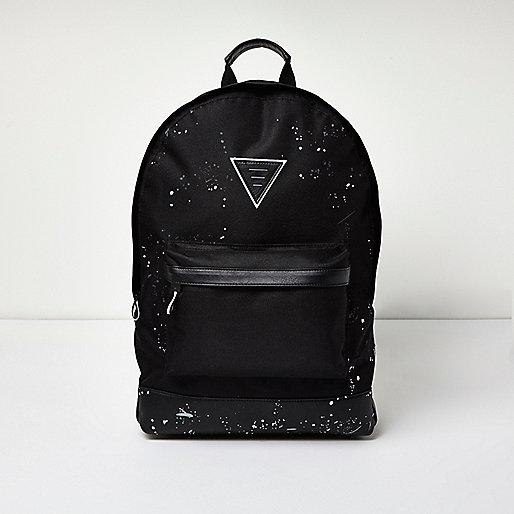 Schwarzer Rucksack mit Farbklecksmotiv