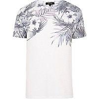 T-shirt blanc avec fleurs sur les épaules
