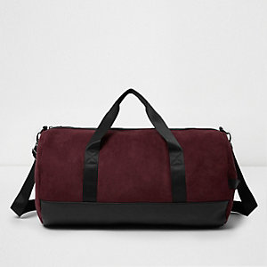 Red faux suede panel holdall bag