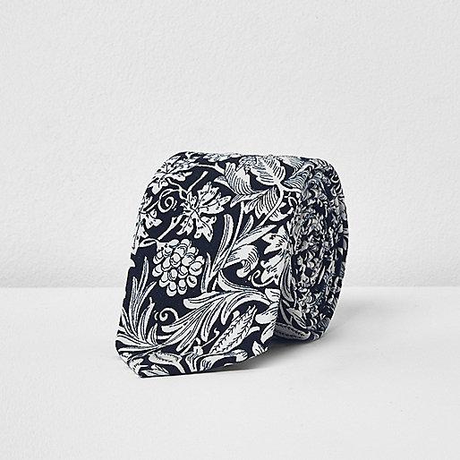Cravate en soie bleu marine à imprimé floral